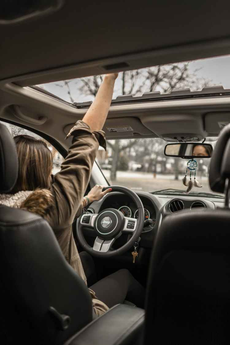 photo of woman driving car